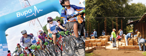 Biking and building, part of Bupa's Global Challenge