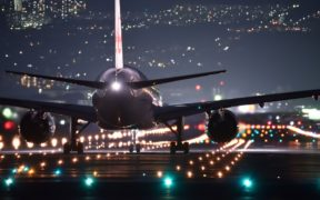 plane on runway at night