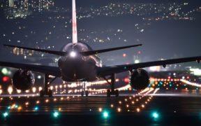 plane on runway at night